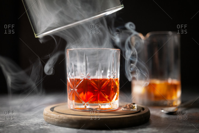 Close up of a smoked Manhattan cocktail making process