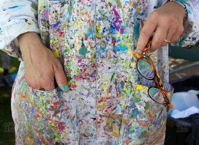 Colorful paint covering a painter's smock