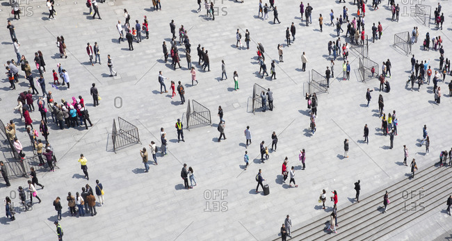 Shanghai, China - April 3, 2016: Chinese people relaxing and walking at the Bund walkway