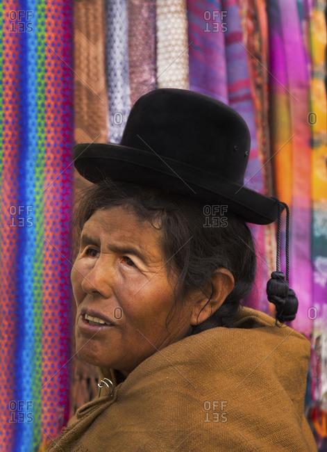 Cusco, Peru - June 23, 2015: Peruvian woman in the Cusco market area wearing a black hat