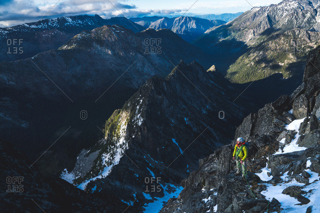 Man with rope standing in mountain scenic vista
