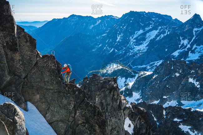 Man climbing rock face in Washington mountains