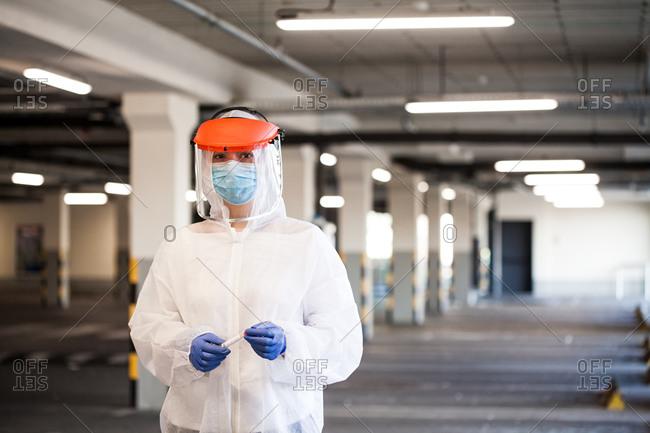 Medical worker holding covid-19 swab sample test kit