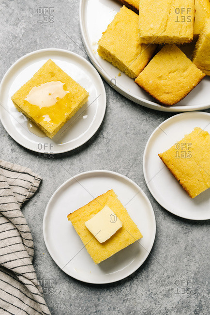 Cornbread squares served on small plates