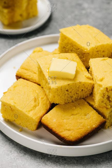 Plate of golden cornbread squares