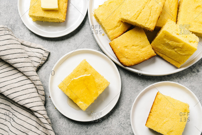 Golden cornbread squares topped with butter or honey