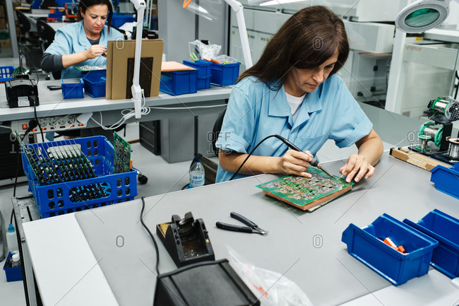Several employees working in a factory on your table