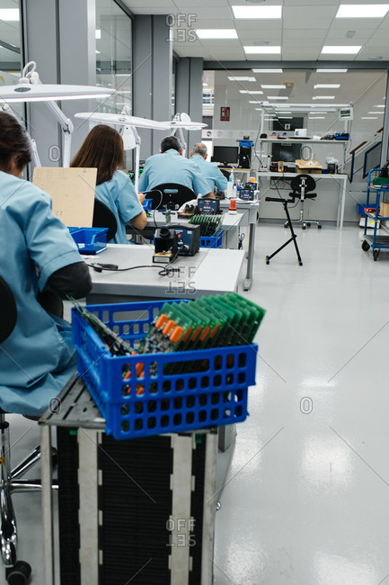 Several workers make the products on their work table