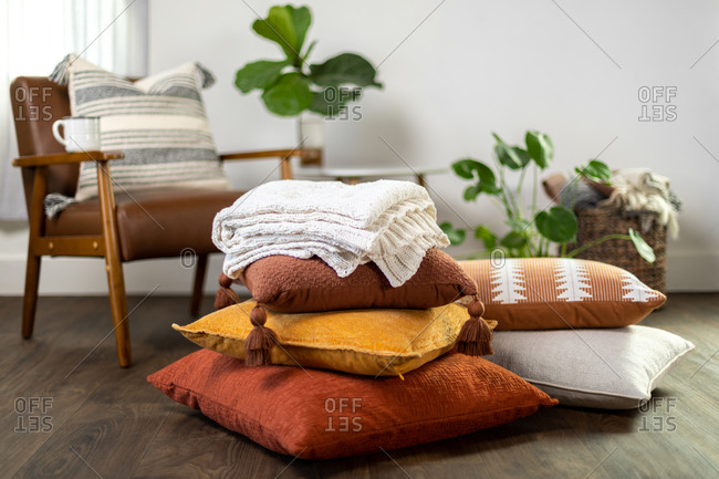 Fall pillows and blanket stacked up