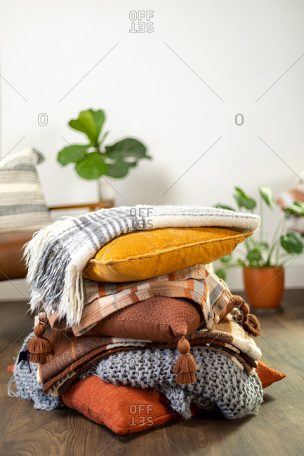 Stack of fall pillows with blankets