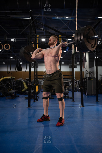 Sportsman doing clean and jerk exercise