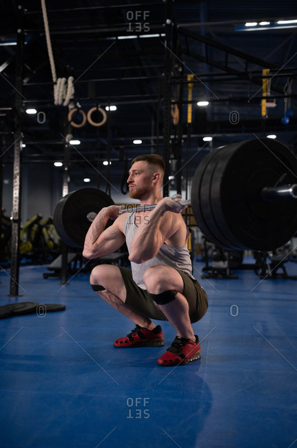 Weightlifter doing front squat in gym