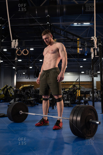 Weightlifter looking at barbell during training