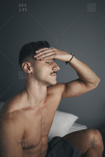 Portrait of a young boy with a moustache and headache