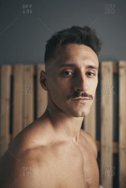 Portrait of a young boy with a moustache