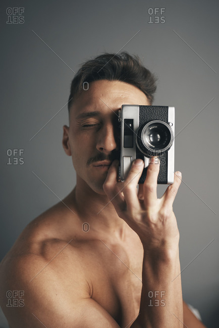 Retro man with moustache with analogical camara