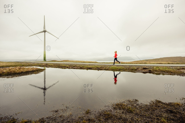 Female athlete jogging near lake