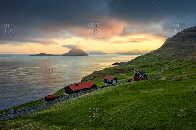 Small settlement near sea at sunset