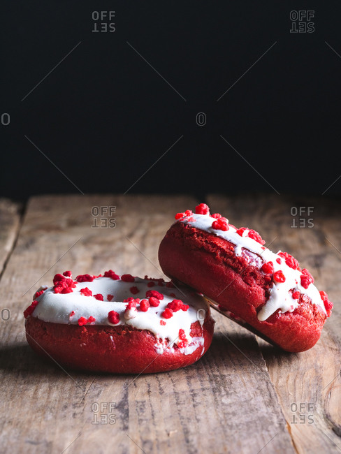 Close up look of two doughnuts on wooden background