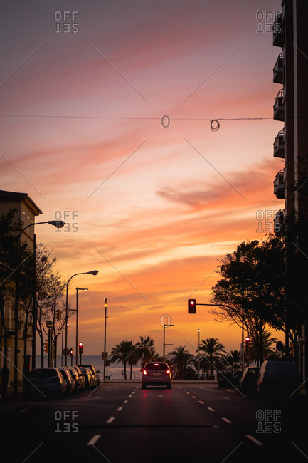 Beautiful sunset view from a city street looking to the sea