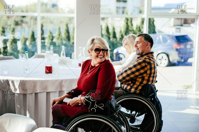 People in wheelchairs at a conference
