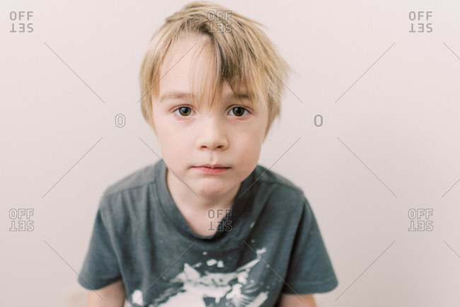 Little boy looking into the camera