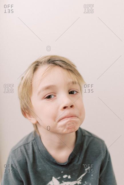 Little boy making a grimace