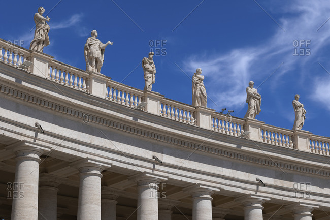 September 1, 2020: Saint statues on St. Peter's Basilica against blue sky on sunny day- Vatican City- Rome- Italy