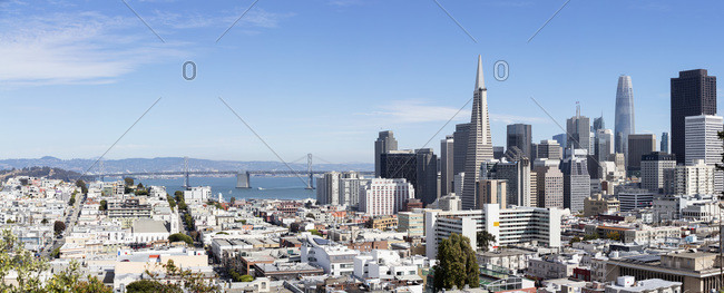 Financial district with Oakland Bay Bridge in background at San Francisco- California- USA