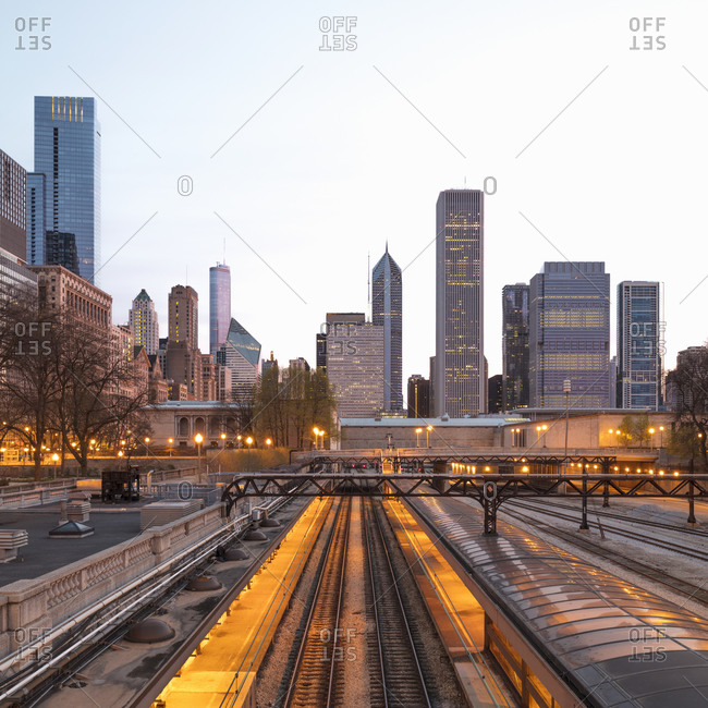 April 22, 2017: Illuminated railway tracks against buildings in city Chicago- USA