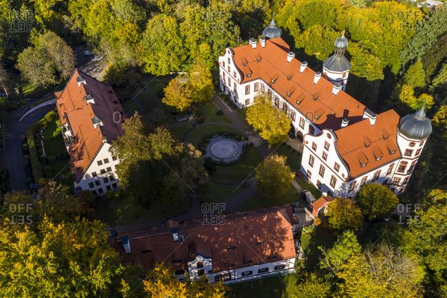 Germany- Bavaria- Eurasburg- Helicopter view of Eurasburg Castle in summer