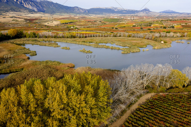 Scenic view of Ebro River by landscape during autumn