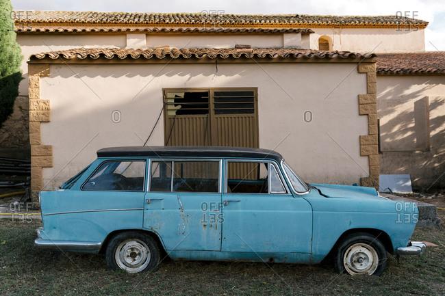 October 4, 2020: Abandoned old vintage car against house