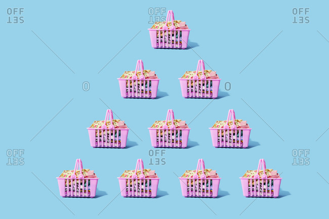 Studio shot of pink shopping baskets arranged in triangle