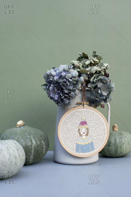 Pumpkins- jug with dried hydrangeas and winter motif embroidery