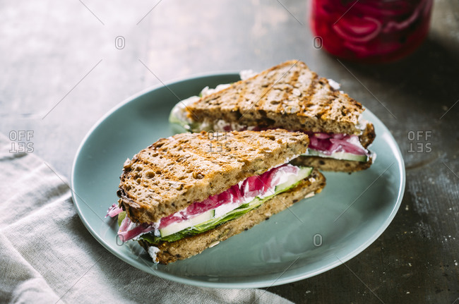 Grilled sandwiches with cucumbers- creamed goat cheese and pickled onions
