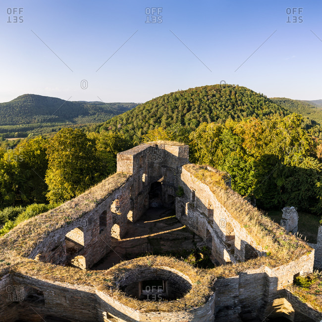 Germany- Rhineland-Palatinate- Walls of Grafenstein Castle with forested hills in background
