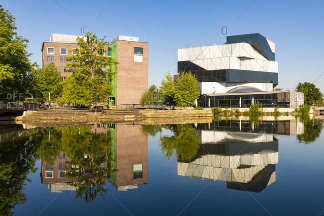 May 19, 2020: Germany- Baden-Wurttemberg- Heilbronn- Experimental science center reflecting in river Neckar