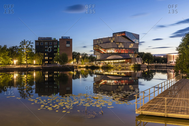 May 19, 2020: Germany- Baden-Wurttemberg- Heilbronn- Experimental science center reflecting in river Neckar at dusk