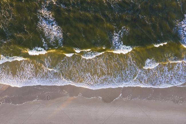 Aerial view of edge of sandy coastal beach of Baltic Sea