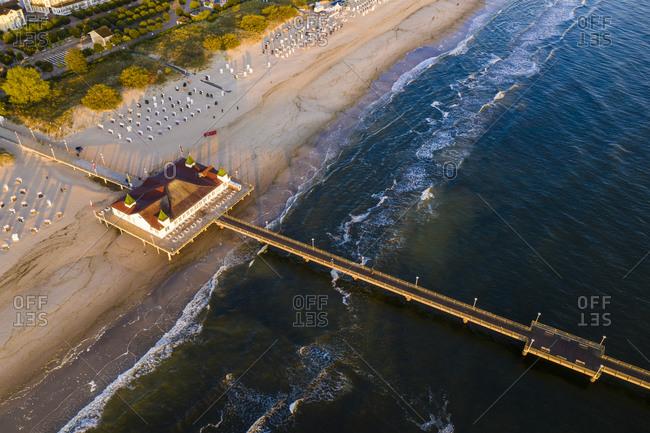 Germany- Mecklenburg-Western Pomerania- Heringsdorf- Aerial view of coastal pier at dawn