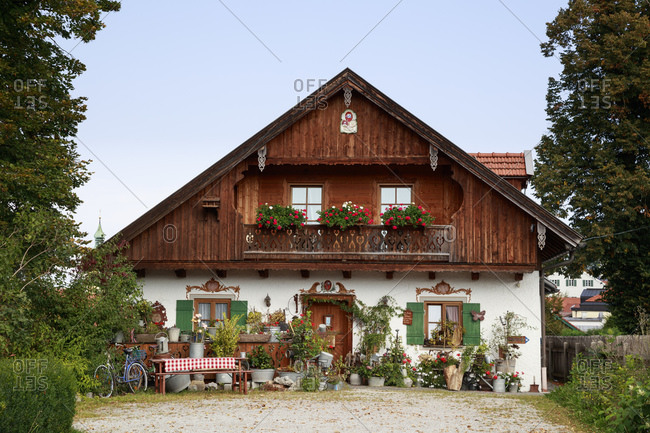 September 17, 2020: Rustic cottage decorated with flowers in spring