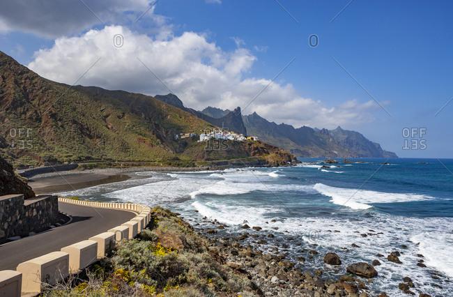 Spain- Province of Santa Cruz de Tenerife- Almaciga- Highway stretching along rugged shore of Tenerife island