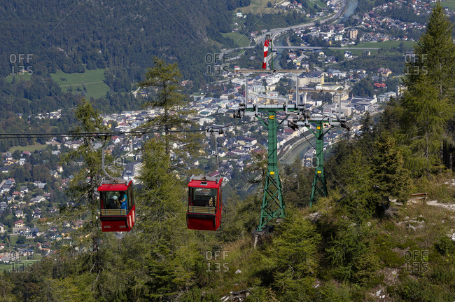 Austria- Upper Austria- Bad Ischl- Overhead cable cars with alpine town in background