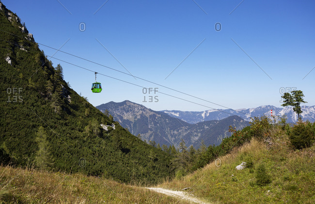 Austria- Upper Austria- Bad Ischl- Overhead cable car moving over forested mountain valley