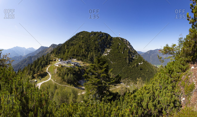 Austria- Upper Austria- Bad Ischl- Overhead cable car station in green forested mountains