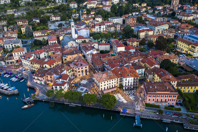October 9, 2020: Italy- Province of Como- Menaggio- Helicopter view of town on shore of Lake Como at dawn