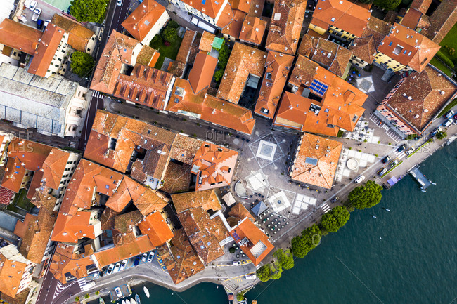 Italy- Province of Como- Menaggio- Helicopter view of houses of lakeshore town