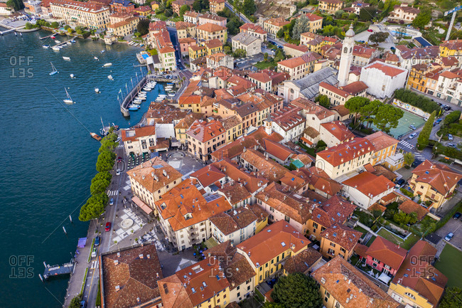 October 9, 2020: Italy- Province of Como- Menaggio- Helicopter view of houses of lakeshore town