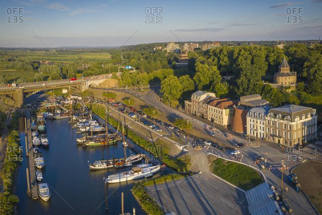 Netherlands- Gelderland- Nijmegen- Aerial view of harbor of riverside city